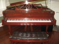 Stunning French Provincial Grand Piano located on