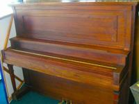This Kindler-Collins piano is tuned, cleaned and in