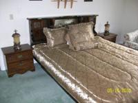 Solid dark wood waterbed suite. It comes with bed, two