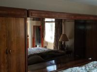 Huge chestnut headboard with mirrors and overhead