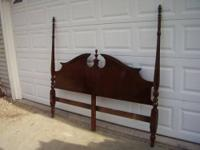 This is a solid wood headboard. It has been refurbished