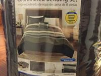 Comforter is reversible with a solid, rich brown