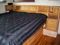 Solid oak kingsize bed with under dresser, lighting,