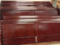 Here we have a few cherry finish king size wooden bed