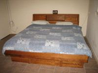 King size converted waterbed for sale. Solid Oak frame