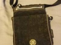 Little Kipling shoulder/travel bag. Black in color, tan