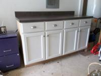 Have a really nice kitchen cabinet with tan patterned
