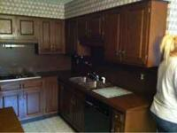 Set of kitchen cabinets and counter top for sale call