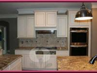 Beautiful all wood kitchen area cabinets and washroom