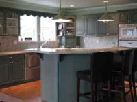 Complete kitchen cabinet set with granite counter tops.