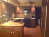 KITCHEN AREA CABINETS AND GRANITE COUNTERTOPS AVAILABLE
