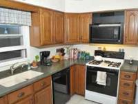For Sale: Oak kitchen cabinets and the Corian solid