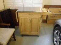 "This kitchen cart is one of the ""Home Styles"" carts"