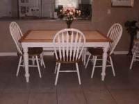 White farmhouse style table and 4 chairs. Pine trim