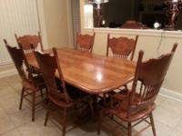 Table with 4 chairs, bar chairs, and china cabinet. All
