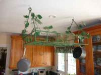Handcrafted kitchen pan rack with grapevine interwoven