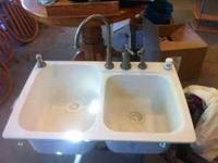 Used Bisque Swanstone kitchen sink, good condition.