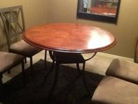 Stone and steel with dark wood top kitchen table and