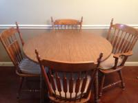 Brown round Kitchen Table includes 2 leaves and 4