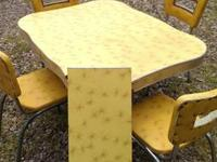 yellow kitchen table with one leaf and 4 chairs one of
