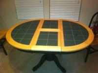 Kitchen table with leaf and four chairs. This table is