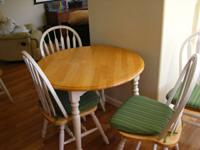 Wooden kitchen table with 5 matching chairs.  Natural