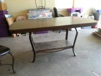 Dark finish kitchen table with 6 chairs.  Like new (its