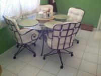 High end, sturdy metal table base and four chairs.