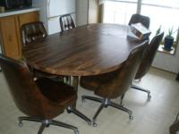 "Sturdy kitchen table measures 71"" by 41"" and has leaf"