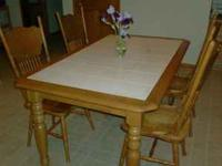 Country style kitchen table and four high-back wooden