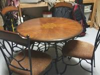 For sale is a lovely kitchen table and four piece chair
