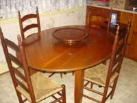 Solid cherry oval kitchen table and six chairs $300.00.
