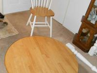 "This is a Country Style 42"" round table with an 18"""