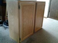 Very nice kitchen cupboard.  Left side finished.