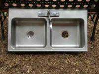 37 inch X 20 inch. Stainless steel sink with faucet.