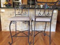 Two counter stools with matching desk chair. Black iron