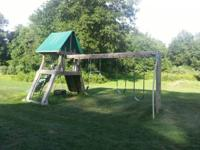 "This is a Kloter Farms ""Cliff Climb"" Playscape that has"