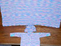 I knit infant baby sweater sets in a variety of colors.