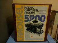 Kodak 5200 Carousel Projector. Features manual, and a