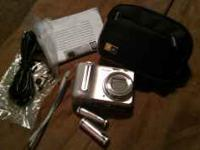 BRAND NEW camera with case, wrist strap, USB cord,