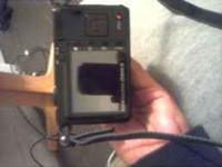 this is a black kodak digital easyshare camera its