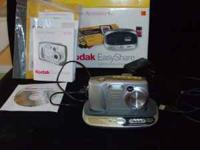 Kodak EasyShare Camera + base, usb cord, charger, and