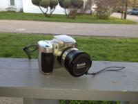 Easy to use camera. Comes with carrying case, AV