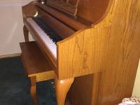 Very gently used Kohler and Campbell Upright Piano.
