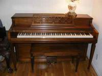 Pictured below is my mother's gorgeous spinet piano.