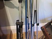 have two tripods and one stand.Two movie video cameras,