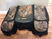 Kolpin Rear Rack Bag. Device is 3 separate bags with a