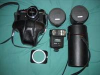 KONICA AUTOREFLEX TC WITH 4 LENSES, FLASH, AND CASES.