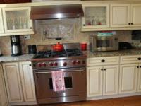 Solid maple Kraftmaid Cabinets and granite countertops