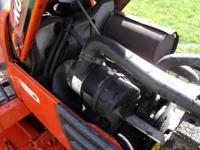 SELLING OUR KUBOTA WE BOUGHT A LARGER ONE. IT IS A 21